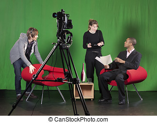 Setting up for a TV Recording - A crew member arranges...