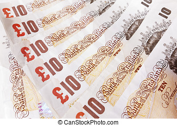 Ten Pound Note Background - Close-up of a line of ten pound...