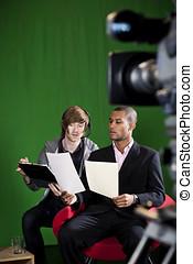 Floor Manager briefing Presenter in TV Studio - Floor...