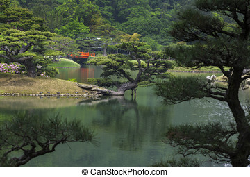Japanese Garden with Red Bridge - Japanese garden with a...