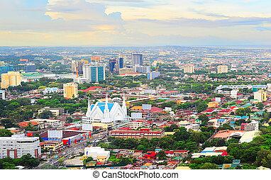 Metro Cebu at sunset - Panorama of Cebu city. Cebu is the...