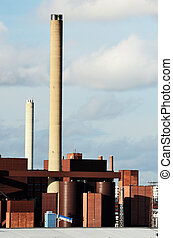 industrial building and chimney against the sky - industrial...