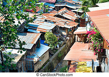 Cebu slums - Aerial view on slums at night in Cebu city,...