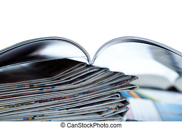 stack of newspapers, magazine, and keyboard close-up on...