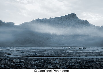mist river and mountain - It is a river with mist and...