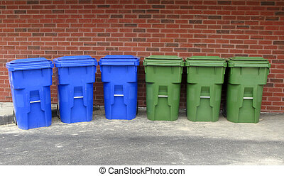 Recycling bins - blue and green recycling bins against a...