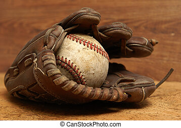 Vintage Glove and Baseball - An old baseball inside a well...