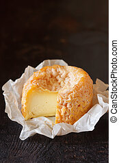 Cheese - French cheese Langres on an old wooden background