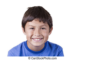Young boy with plaster on forehead - on white background