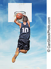 dunking in the sky - basketball player dunking with the sky...