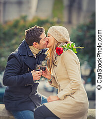 couple with a rose kissing on valentines day - young man...