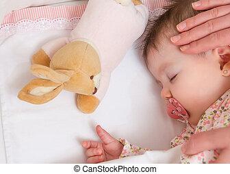 Hands of mother caressing her baby girl sleeping - Hands of...