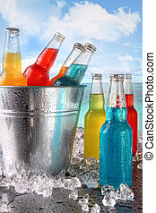Cool drinks in ice bucket at the beach - Cool summer drinks...