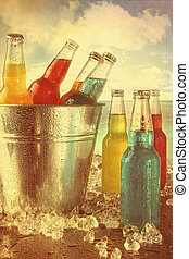 Cool drinks in ice bucket at the beach with vintage look