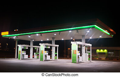 gas station by night - green and white gas station by night