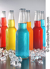 Cool summer drinks with ice on bright background