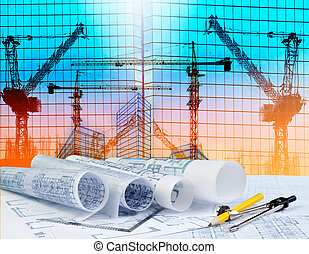 architecture plan on architect working table with building and reflection of crane construction on mirror building