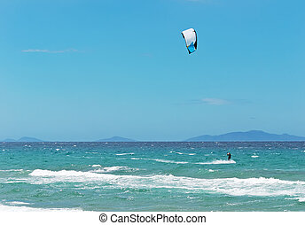 kitesurfer on a clear, windy day
