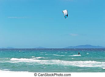 kitesurfer on a clear, windy day