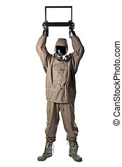 Man in Hazard Suit holding a laptop over his head - A man...