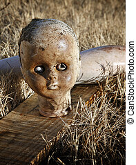Abandoned Doll - Close up portrait of spooky abandoned old...