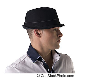 Attractive young man with fedora and white shirt, isolated...