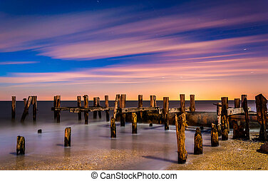 Ruins of an old pier on Sunset Beach at night, in Cape May, New Jersey.
