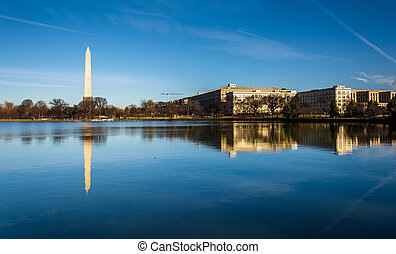 The Washington Monument reflecting in the Tidal Basin,...