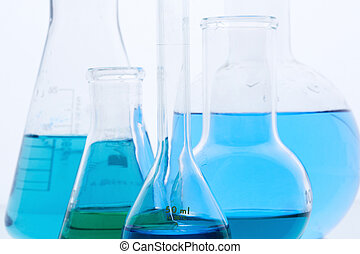 Flasks - Image of several flasks with blue liquid in...