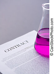 Contract and tube - Test-tube with purple liquid over paper...