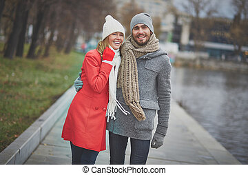 Walk in park - Portrait of affectionate couple taking a walk...
