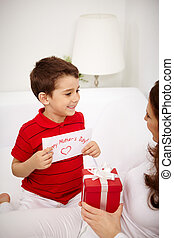 Congrats - Cute lad with congratulating card looking at his...
