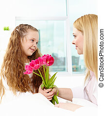 Giving tulips to mother