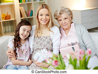 Happy family - Portrait of happy little girl, her mother and...