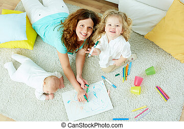 Babysitter with kids - The above-view portrait of a...