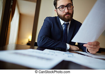 Businessman with paper - Serious businessman with document...