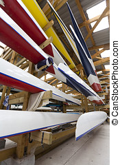 Inside a Boathouse - Low, wide-angle view of boats stored...