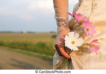 Bride on Farm Road holding five flowers