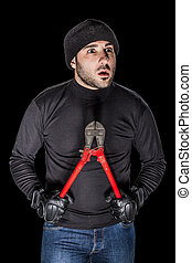 Criminal - a burglar wearing black clothes holding huge wire...