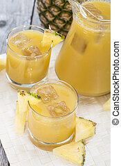 Pineapple Juice in a glass with fresh fruits