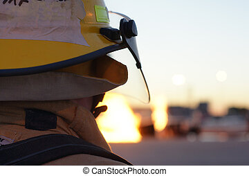 Fire Fighter - fire fighter looking at a fire