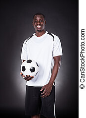 Happy Soccer Placer Holding Football - Portrait Of A Happy...