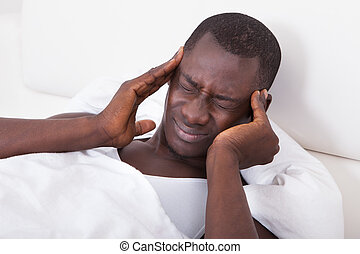 Young Man Having Headache - Young African Man Having...