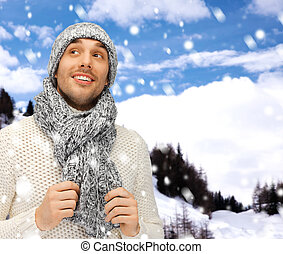 handsome man in warm sweater, hat and scarf - winter...