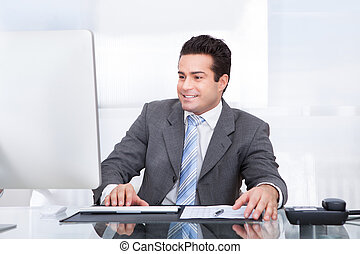 Young Businessman Using Computer - Portrait Of Young...
