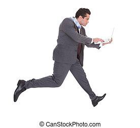 hombre de negocios, Utilizar, computador portatil, mientras,...