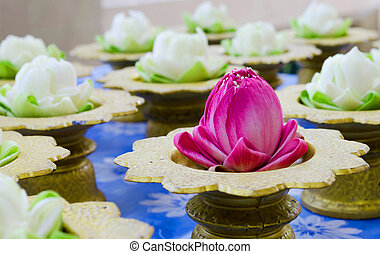 Lotus flower garlands on tray
