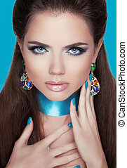 Stare. Beautiful woman with jewelry fashion accessories. Make-up.