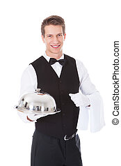 Waiter Holding Cloche Lid Cover - Young Male Waiter Holding...