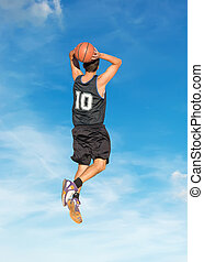 slam dunk in the sky - basketball player dunking in the sky